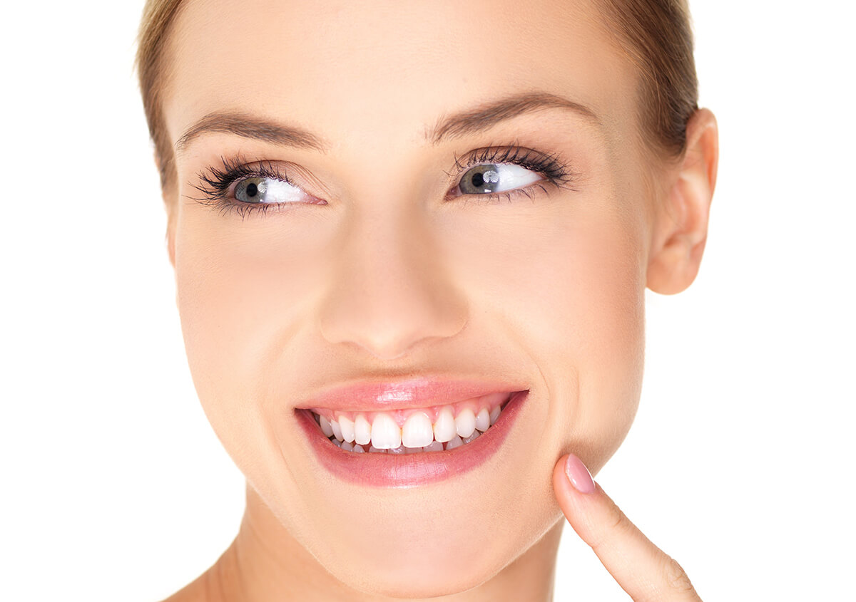 Happy woman smiling showing bright white teeth